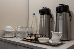 coffee-urns-biscuits-and-water-in-meeting-room
